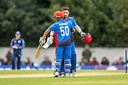 Rahmat Shah (#08) is congratulated by Hashmatullah Shaidi (#50) as he makes 100 runs during the One Day International match between Scotland and Afghanistan at The Grange Cricket Club, Edinburgh, Scotland on 10 May 2019.