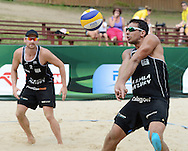 STARE JABLONKI POLAND - July 5: Jonathan Erdmann /1/ and Kay Matysik of Germany in action during Day 5 of the FIVB Beach Volleyball World Championships on July 5, 2013 in Stare Jablonki Poland.  (Photo by Piotr Hawalej)