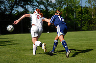4 MAY 2010 -- ST. LOUIS -- Visitation Academy girls' soccer player Courtney Young (11) battles St. Dominic's Christina Lifritz (12) during a game between the two schools Tuesday, May 4, 2010 at Visitation in St. Louis. Visitation won the match, 2-1. Photo © copyright 2010 by Sid Hastings.