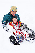 A mother and son sledding in Utah's Wasatch Mountains.