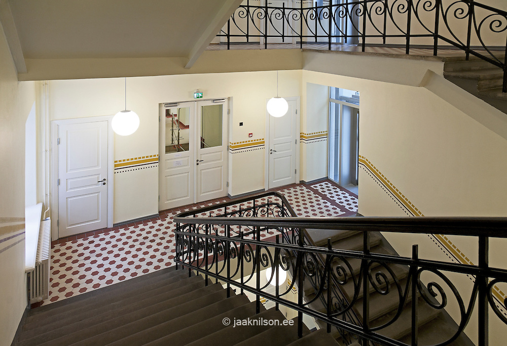Stair well with checked red and white floors in Tartu University, Estonia