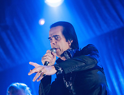 Frontman Nick Cave points to the crowd, of Nick Cave and the Bad Seeds, on stage tonight at The Barrowlands, Glasgow, Scotland.<br /> &copy;Michael Schofield.