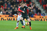 Xherdan Shaqiri tackles Oleksandr Zinchenko during the Premier League match between Stoke City and Manchester City at the Bet365 Stadium, Stoke-on-Trent, England on 12 March 2018. Picture by Graham Holt.