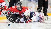 Game action as Canada takes on the USA in sledge hockey semifinal action on March 13, 2014 at the Shayba Arena in Adler during the XI Paralympic Winter Games in Sochi, Russia.