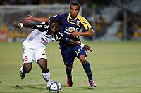FOOTBALL - FRENCH CHAMPIONSHIP 2010/2011 - L1 - AC ARLES AVIGNON v RC LENS - 14/08/2010 - PHOTO PHILIPPE LAURENSON / DPPI - SERGE AURIER (LEN) / CHAFIK NAJIH (ACA)