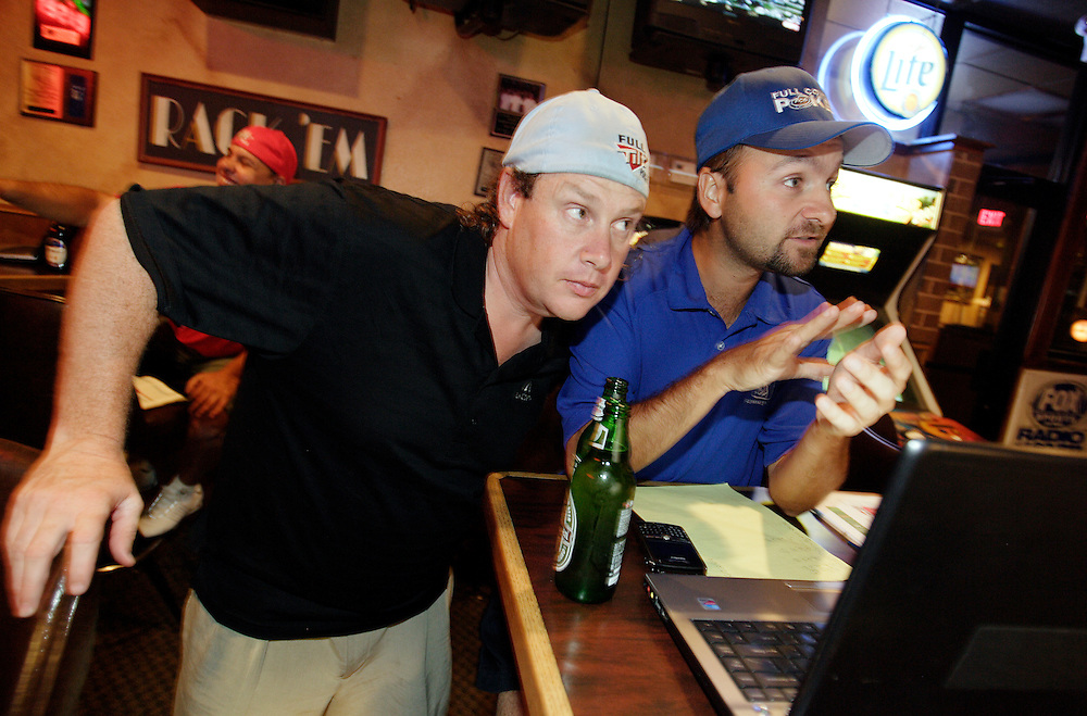 LAS VEGAS, NEVADA, August 19, 2007: Professional Poker players Daniel Negreanu, in blue, and Gavin Smith were in Las Vegas, Nevada on August 19, 2007 to participate in a fantasy football league whereby participants purchase players at a draft auction and then track the  performance of those players throughout the year and accumulate points.