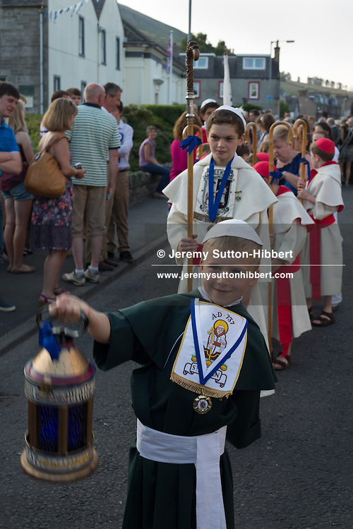 The Cleikum Ceremonies, during the St. Ronan's Games, in Innerleithen, in the Borders, Scotland, Friday 19th July 2013. Standard Bearer Lyle Caine, St Ronan Dux Boy Kieran Frost, Dux Girl Emily McNeill.