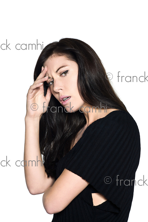 studio shot portrait on isolated white background of a Beautiful Woman migraine headache displeased annoyed