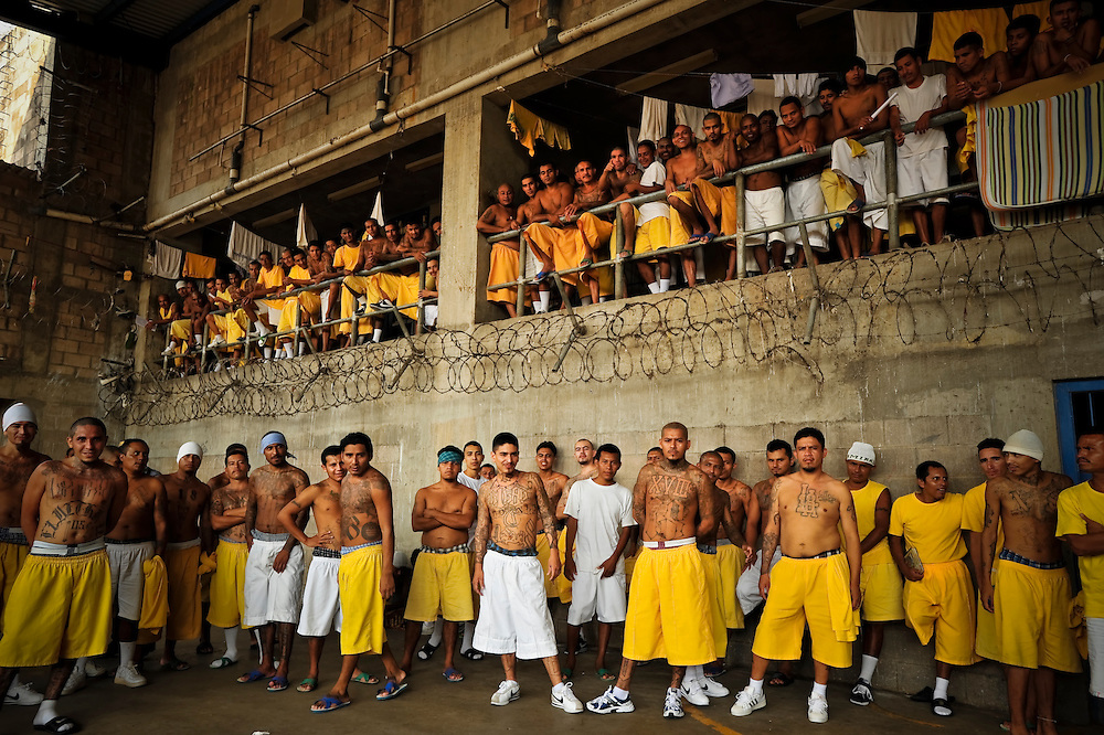 Members of the MS-18 gang incarcerated in Izalco mens' prison in El Salvador inside pass the afternoon in the prison yard.