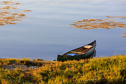A canoe on the shoreline of Lanes Island in Casco Bay. Yarmouth, Maine.