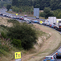 Stationary traffic queing on the A9 south of Auchterarder in Pertyshire after the A9 was closed in both directions after the body of a young woman was found on the carriageway.<br />