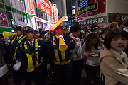 Police try to control the crowds of young people in costume during the Halloween celebrations in Shibuya, Tokyo, Japan. Wednesday October 31st 2018 .  Halloween has grown massively popular  in Japan over the last few yers. Primarily an event for young adults who use it as a chance to dress up in inventive costumes and spend the night partying . In recent years the misbehaviour of some revellers has caused a heavier police presence on the street and  a push back from the Japanese society, and media  who see no need for nor benefits to this western cultural import.