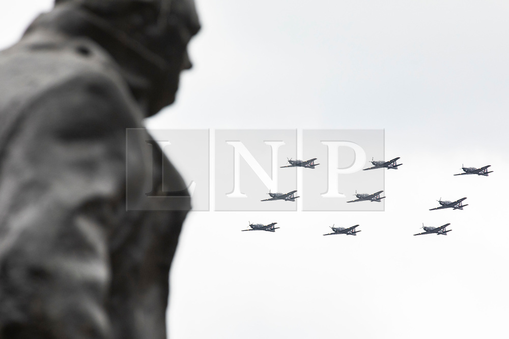 © Licensed to London News Pictures. 10/07/2018. London, UK. RAF Tucano T1 aircraft fly past the Winston Churchill statue in Parliament Square as part of the RAF100 flypast which celebrates the centenary of the Royal Air Force. Photo credit: Rob Pinney/LNP