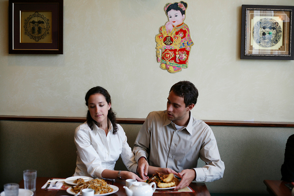 BOSTON, MA--Jul 20, 2007--Lisa Peña of Venice (left) and Benjamin Lemaitre of France share lunch at Five Spice China Bistro in Quincy...GLOBE PHOTO BY ZARA TZANEV