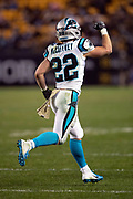 Carolina Panthers running back Christian McCaffrey (22) pumps his fist in celebration as he jogs off the field after running for a fourth quarter touchdown that cuts the Pittsburgh Steelers lead to 52-21 during the NFL week 10 regular season football game against the Pittsburgh Steelers on Thursday, Nov. 8, 2018 in Pittsburgh. The Steelers won the game 52-21. (©Paul Anthony Spinelli)