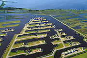 Nederland, Overijssel, Wanneperveen, 27-08-2013;<br /> Beulakerwijde, een watersport- en recreatiegebied met recreatiewoningen in Giethoornse stijl.<br /> Beulakerwijde, a sports and recreation area with holiday homes in country style.<br /> luchtfoto (toeslag op standaard tarieven);<br /> aerial photo (additional fee required);<br /> copyright foto/photo Siebe Swart.