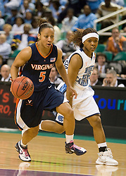 Virginia guard Sharnee Zoll (5) dribbles past North Carolina guard Cetera DeGraffenreid (22).  The #4 seed/#25 ranked Virginia Cavaliers women's basketball team fell to the #1 seed/#2 ranked North Carolina Tar Heels 80-65 in the semifinals of the 2008 ACC Women's Basketball Tournament at the Greensboro Coliseum in Greensboro, NC on March 8, 2008.
