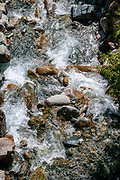 Close up of the Inn River as it flows near Lavin is a municipality in the district of Inn in the Swiss canton of Graubünden