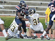 Samford wide receiver Kelsey Pope is grabbed by Appalachian State defensive back Patrick Blalock (34) at Seibert Stadium in Homewood, Ala., Saturday, Oct 13, 2012. (Marvin Gentry)