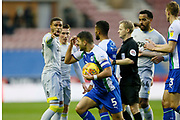 Wigan Athletic midfielder Sam Morsy (5) alleges a headset by Derby County midfielder Harry Wilson (7) during the EFL Sky Bet Championship match between Wigan Athletic and Derby County at the DW Stadium, Wigan, England on 8 December 2018.