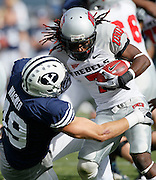 UNLV wide receiver Michael Johnson (7) is tackled by BYU linebacker Jadon Wagner after catching a pass for a first down during the first half of an NCAA college football game at LaVell Edwards Stadium, Saturday, Nov. 6, 2010, in Provo, Utah.  (AP Photo/Colin E. Braley)