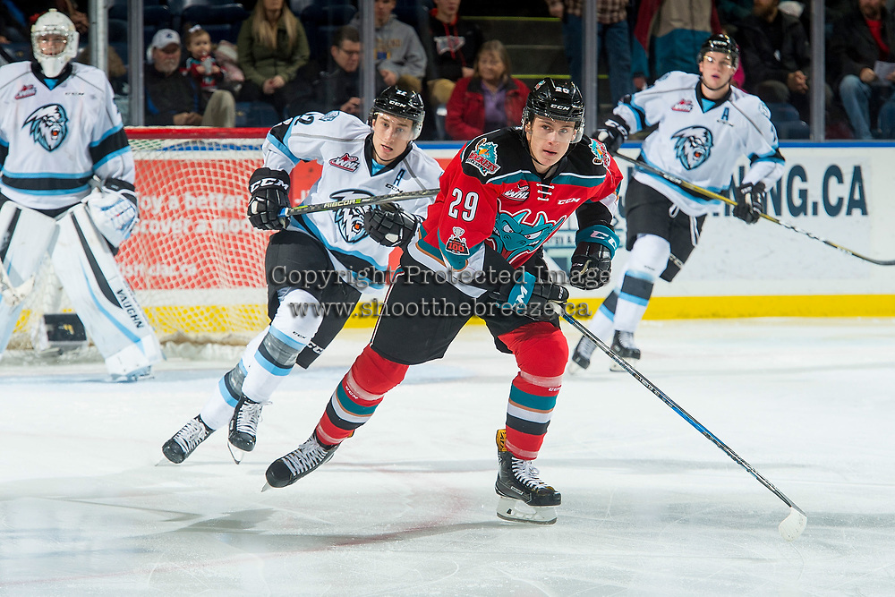 KELOWNA, CANADA - DECEMBER 2: Brett Davis #22 of the Kootenay Ice back checks Nolan Foote #29 of the Kelowna Rockets on December 2, 2017 at Prospera Place in Kelowna, British Columbia, Canada.  (Photo by Marissa Baecker/Shoot the Breeze)  *** Local Caption ***