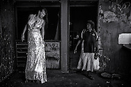 Gypsie is just checking out her silver dress which she bought from the OpShop while Betsy just walked out the house, very surprised to see Gypsie standing in that silver dress.<br /> &copy;Ingetje Tadros<br /> Broome, Western Australia<br /> <br /> Runner Up at Australia's Top Emerging Photographers 2015 - Portrait<br /> Finalist at Moran Arts Foundation (AUS) 2014<br /> Honorable mention ND Awards 2014