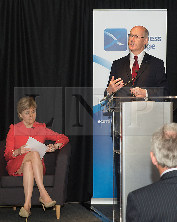 © Licensed to London News Pictures. 26/05/2015. The First Minister, Nicola Sturgeon during a visit to winners of the Scottish Championship, Heart of Midlothian Football Club with Deputy First Minister John Swinney (right) , to deliver her first first economic speech since the general election. Photo credit: Max Bryan/LNP