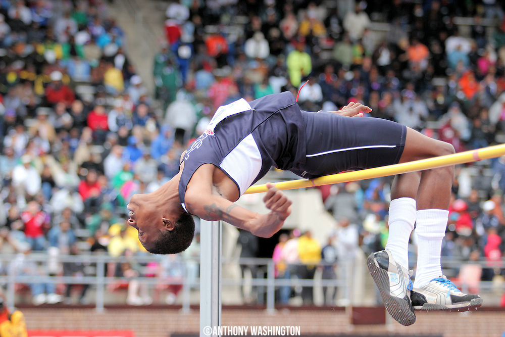 Ashani Wright of Jamaica College makes an attempt at the high jump pit during the High School Boys' High Jump Championship at the Penn Relays athletic meet on Saturday, April 30, 2011 in Philadelphia, PA.