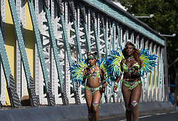 © Licensed to London News Pictures. 28/08/2017. London, UK. Revellers and carnival goers enjoy the second day of the 2017 Notting Hill carnival. The two day event is the second largest street festival in the world after the Rio Carnival in Brazil, attracting over 1 million people to the streets of West London. Photo credit: Ben Cawthra/LNP