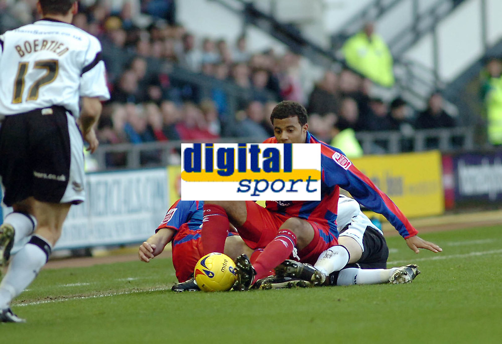 Photo: Kevin Poolman.<br />Derby County v Crystal Palace. Coca Cola Championship. 16/12/2006. Palace player Tom Soares is pulled down onto the floor.