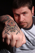 Northern Michigan Tatoo artist Erik Stevenson of Alanson shows off some of his