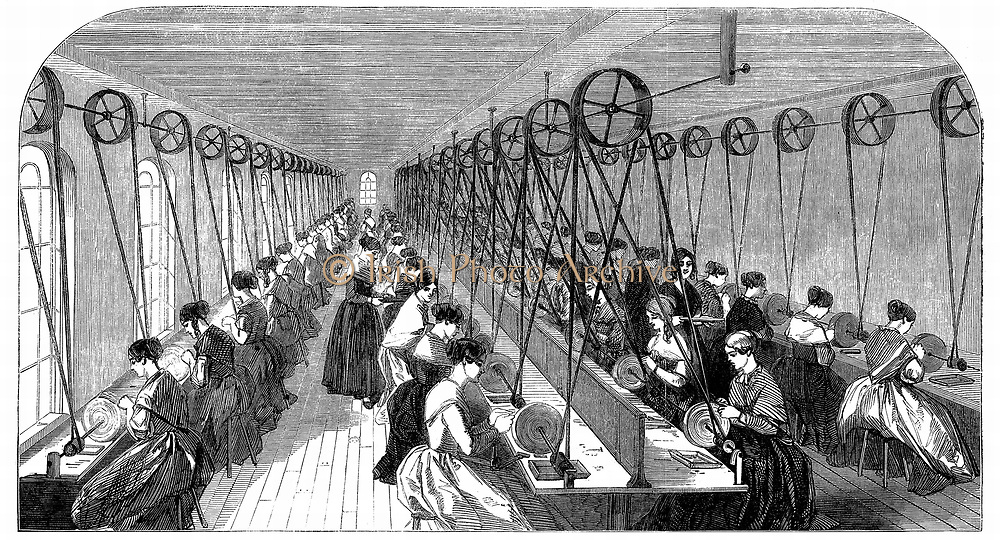 Pen grinding room: Hanks, Wells & Co's factory, Birmingham.  More than 50 women sit at individual grindstones finishing metal pen nibs.  The stones are driven through belt and shafting from central power source.   Wood engraving 1851