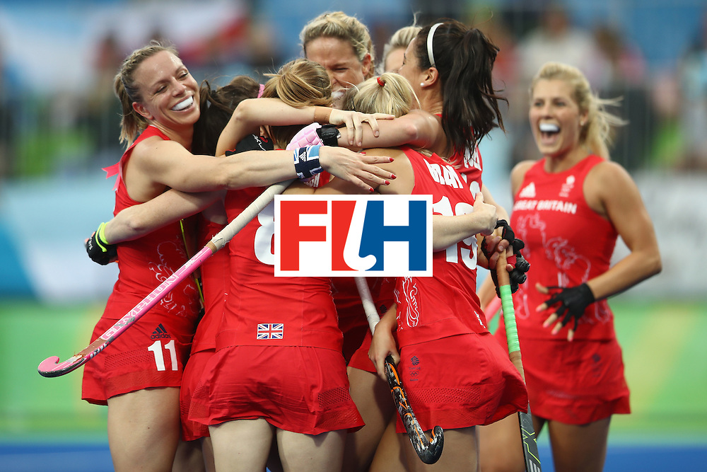 RIO DE JANEIRO, BRAZIL - AUGUST 10:  Helen Richardson-Walsh of Great Britain celebrates with her team after scoring a goal during the women's pool B match between Great Britain and Argentina on Day 5 of the Rio 2016 Olympic Games at the Olympic Hockey Centre on August 10, 2016 in Rio de Janeiro, Brazil.  (Photo by Mark Kolbe/Getty Images)