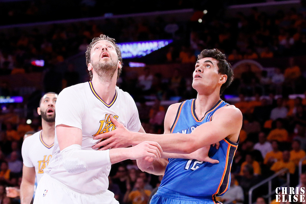 09 March 2014: Los Angeles Lakers center Pau Gasol (16) vies for the rebound with Oklahoma City Thunder center Steven Adams (12) during the Los Angeles Lakers 114-110 victory over the Oklahoma City Thunder at the Staples Center, Los Angeles, California, USA.