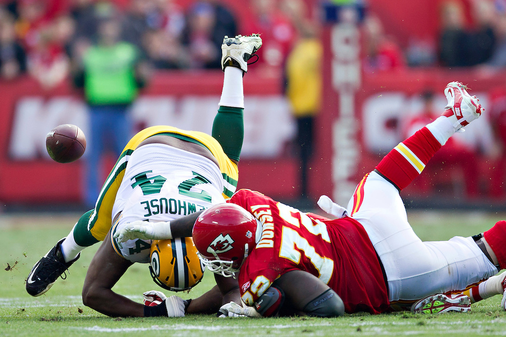 KANSAS CITY, MO - DECEMBER 18:  Marshall Newhouse #74 of the Green Bay Packers fumbles the ball after being tackled by Glenn Dorsey #72 of the Kansas City Chiefs at Arrowhead Stadium on December 18, 2011 in Kansas CIty, Missouri.  The Chiefs defeated the Packers 19-14.   (Photo by Wesley Hitt/Getty Images) *** Local Caption *** Marshall Newhouse; Glenn Dorsey