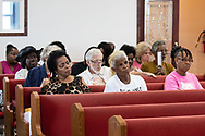 Sharon Lavinge next to Gail LeBoeuf and Barbara Washington at a community meeting explaining Mosaic's proposed plan to manage 500 million gallons of acidic waste water in Convent Louisiana Pleasant Hill Baptist Church in,Convent LA. Mosaic Uncle Sam fertilizer complex in in St. James Parish has a problem with stability of a large waste pile that it is trying to mitigate.