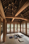Oiso, Kanagawa prefecture, Japan, February 10 2017 - Keiji and Atsuko Suzuki's minka, traditional wooden house, is the last minka home in Oiso. The previous owner of the 3,000 sq. ft. house moved it from the shores of Lake Biwa, near Kyoto, 35 years ago.<br /> Charcoal fireplace in the detached house.
