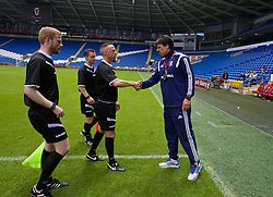 CARDIFF, WALES - Friday, June 5, 2015: Wales' manager Chris Coleman shakes hands with referee Dean John after a practice match at the Cardiff City Stadium ahead of the UEFA Euro 2016 Qualifying Round Group B match against Belgium. (Pic by David Rawcliffe/Propaganda)