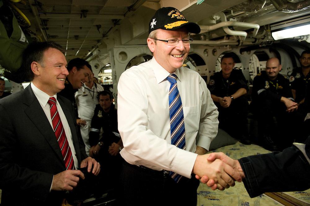 Australian Prime Minister Kevin Rudd talks with crew aboard the submarine HMAS Collins at Garden Island, Western Australia.