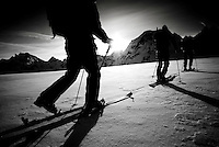 A group of skiers traverse the Mont Collon Glacier, Haute Route, Switzerland.