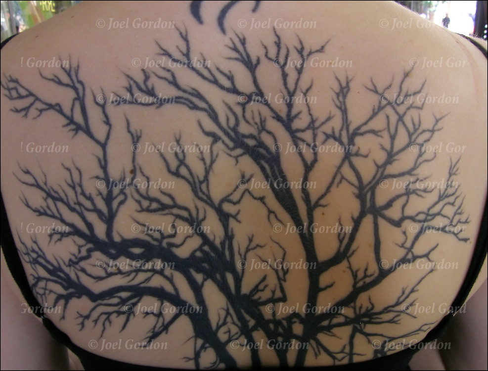 Tree tattoo covering her entire back.<br /> Tattoos once were considered to be form of anti-conformist but not anymore.