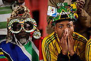 Fans of South Africa sit dejected after watching his team lose 1-0 to Brazil