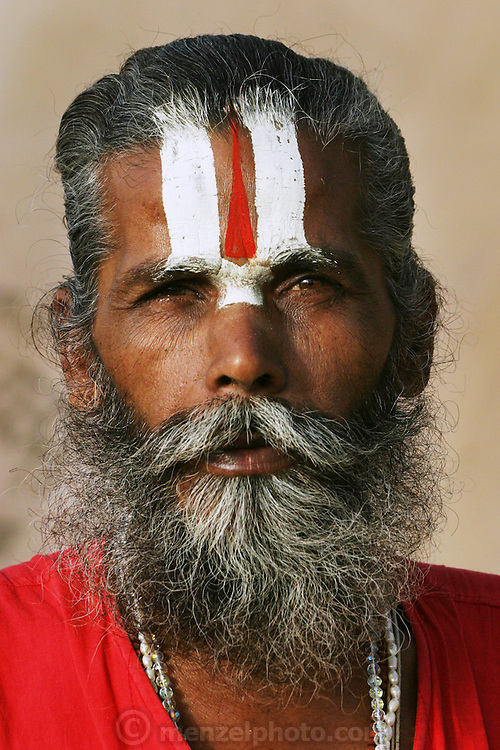 A Sadhu (Hindu ascetic) during the Kumbh Mela festival, Ujjain, Madhya Pradesh, India. The Kumbh Mela festival is a sacred Hindu pilgrimage held 4 times every 12 years, cycling between the cities of Allahabad, Nasik, Ujjain and Hardiwar. Past Melas have attracted up to 70 million visitors.