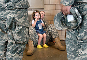 06/25/07-(Harrisonburg).Sgt. Aaron Katz, sits on the floor with his neice, Lucy Laing, 3,in the Harrisonburg National Guard Armory on Monday. Katz, from Grottoes, was being deployed with his unit to Iraq..(Pete Marovich/Daily News-Record)