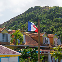 France, Guadeloupe, Les Saintes. Red roofs and French flags of Les Saintes, Guadeloupe.