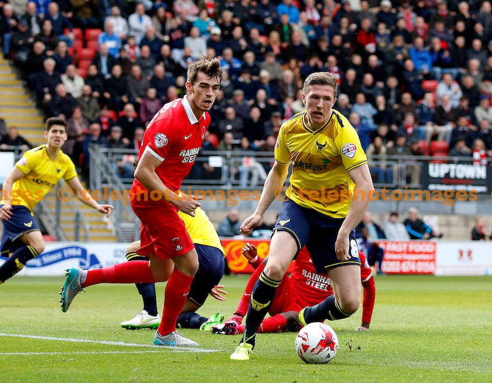 John Lundstram of Oxford United sees off the danger during the Sky Bet League 2 match between Leyton Orient and Oxford United at the Matchroom Stadium in London. October 17, 2015.<br /> Carlton Myrie / Telephoto Images<br /> +44 7967 642437
