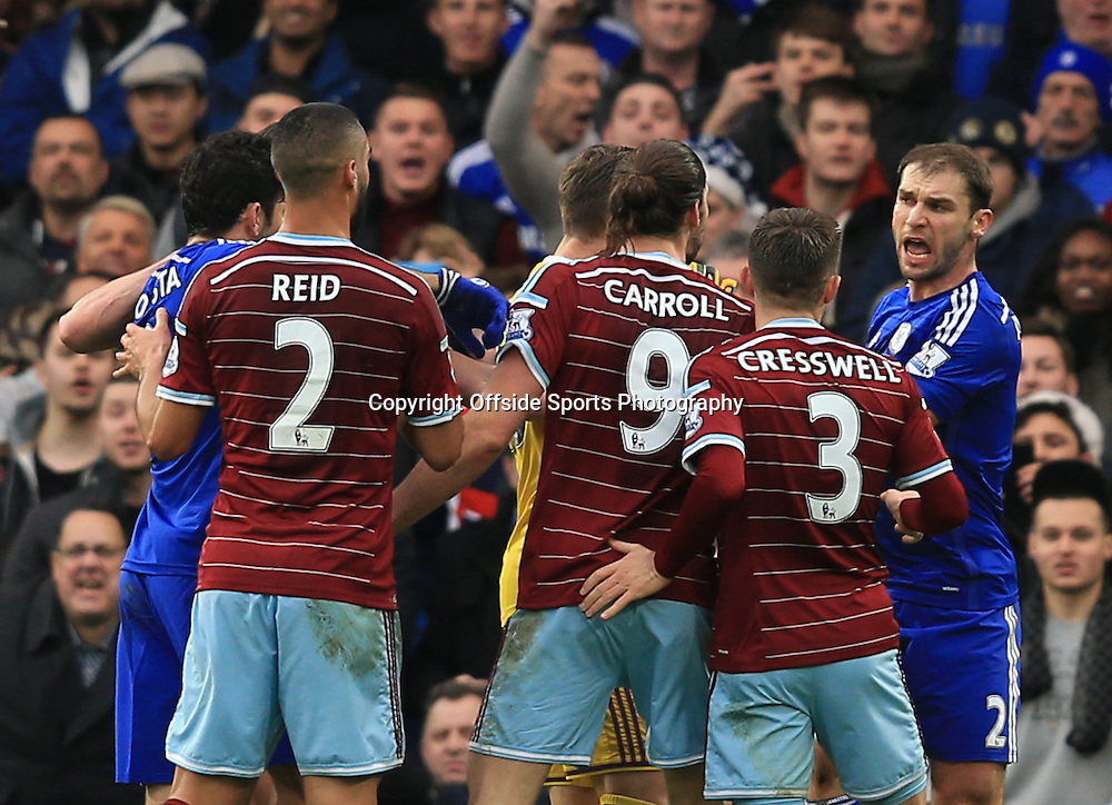26 December 2014 - Barclays Premier League - Chelsea v West Ham - Tempers flare between as West Ham players accuse Branislav Ivanovic of Chelsea of diving -  Photo: Marc Atkins / Offside.