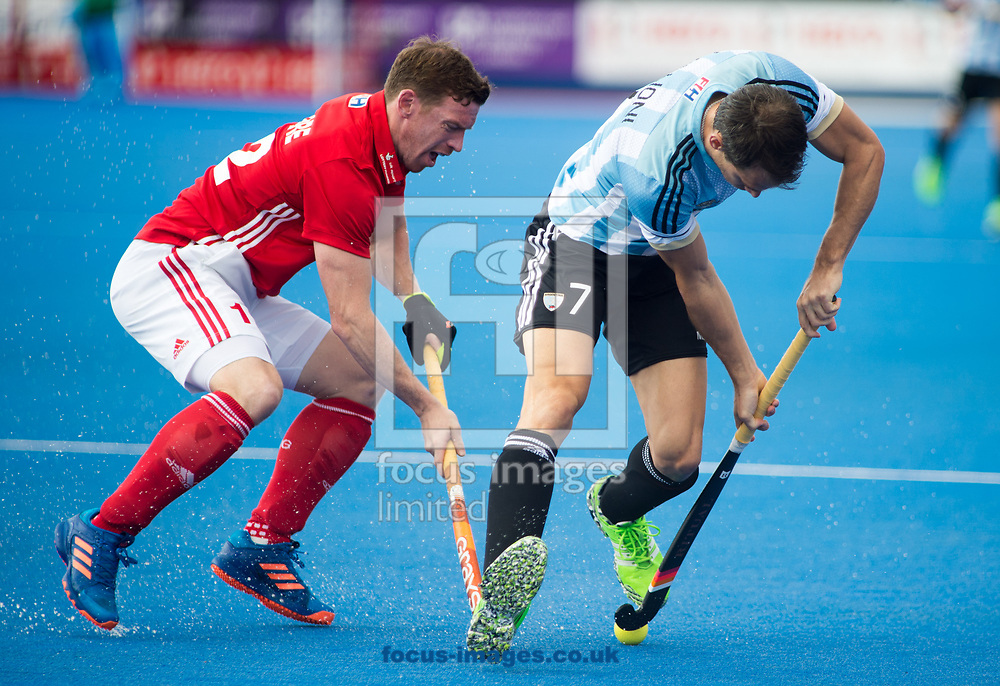 Harry Gibson of England and Facundo Callioni of Argentina battle for the ball on day four of the Men's Hero Hockey World League Semi-Finals at Lee Valley Hockey Centre, Stratford<br /> Picture by Hannah Fountain/Focus Images Ltd 07814482222<br /> 18/06/2017