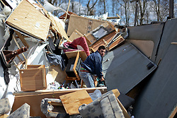 24 February 2016. Sugar Hill RV Park, Convent, Louisiana.<br /> Scenes of devastation following a deadly EF2 tornado touchdown. 2 confirmed dead. <br /> Juan Cuevas attempts to rescue all he can from his smashed trailer. Cuevas was in the trailer when the storm hit and counts himself lucky to be alive.<br /> Photo©; Charlie Varley/varleypix.com